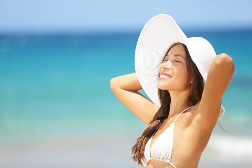 woman on the beach - summer skincare