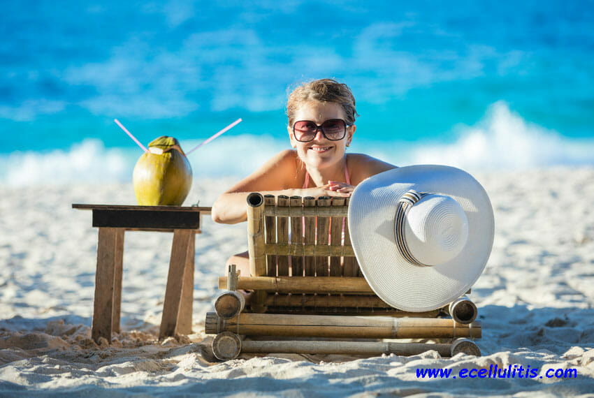skin health tips for summer - woman with coconut cocktail - Why does my skin peel?